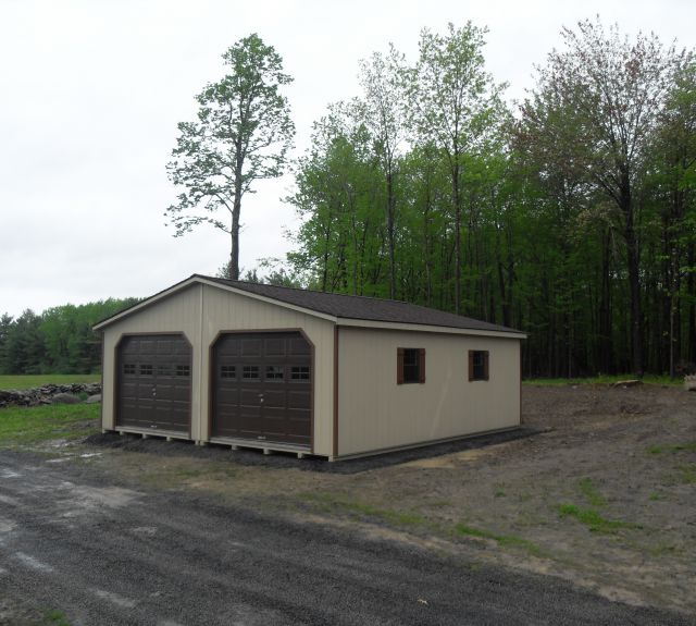 24x26 modular tan paint, light brown trim, hickory shingles, 7'4 walls 9x7'6 oh 3 pitch roof