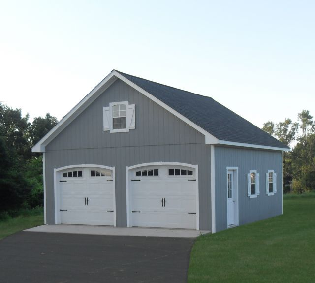 24x26 wood 2 story garage with curved trim