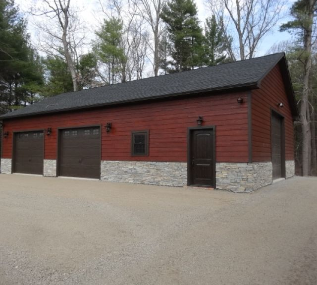 30x50 truss series garage with stone front